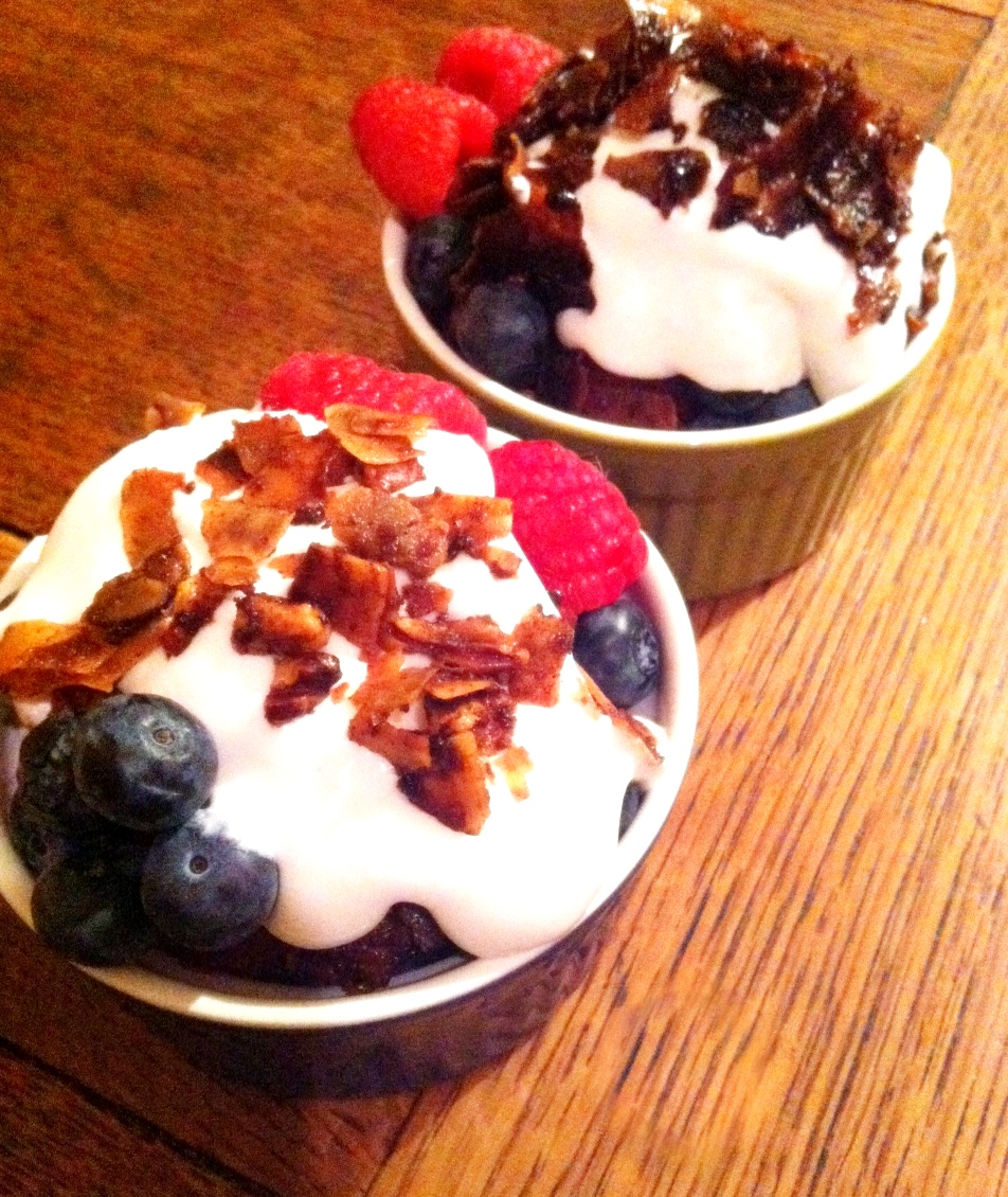 Raspberries and blueberries with coconut cream and coconut crack
