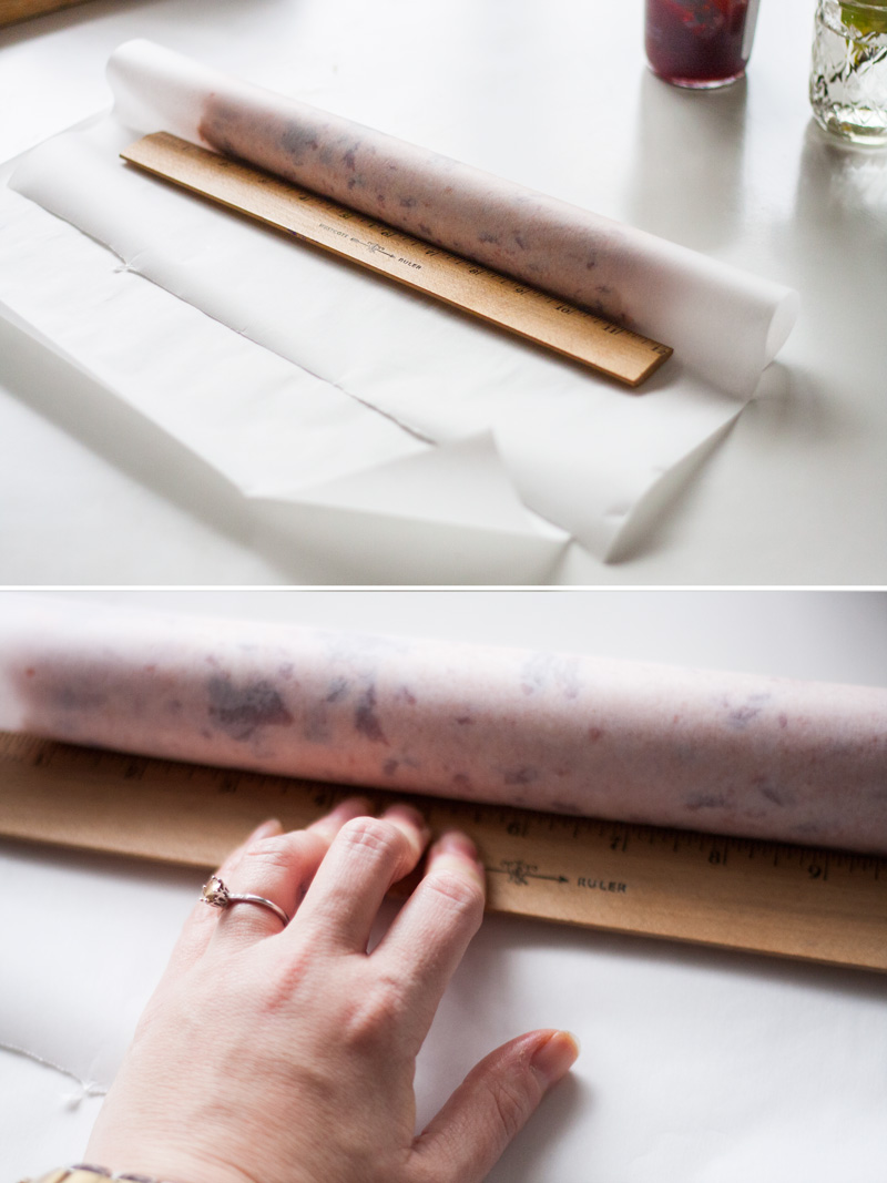 Form the log by folding over one end of the parchment and tightening with a straight edge.