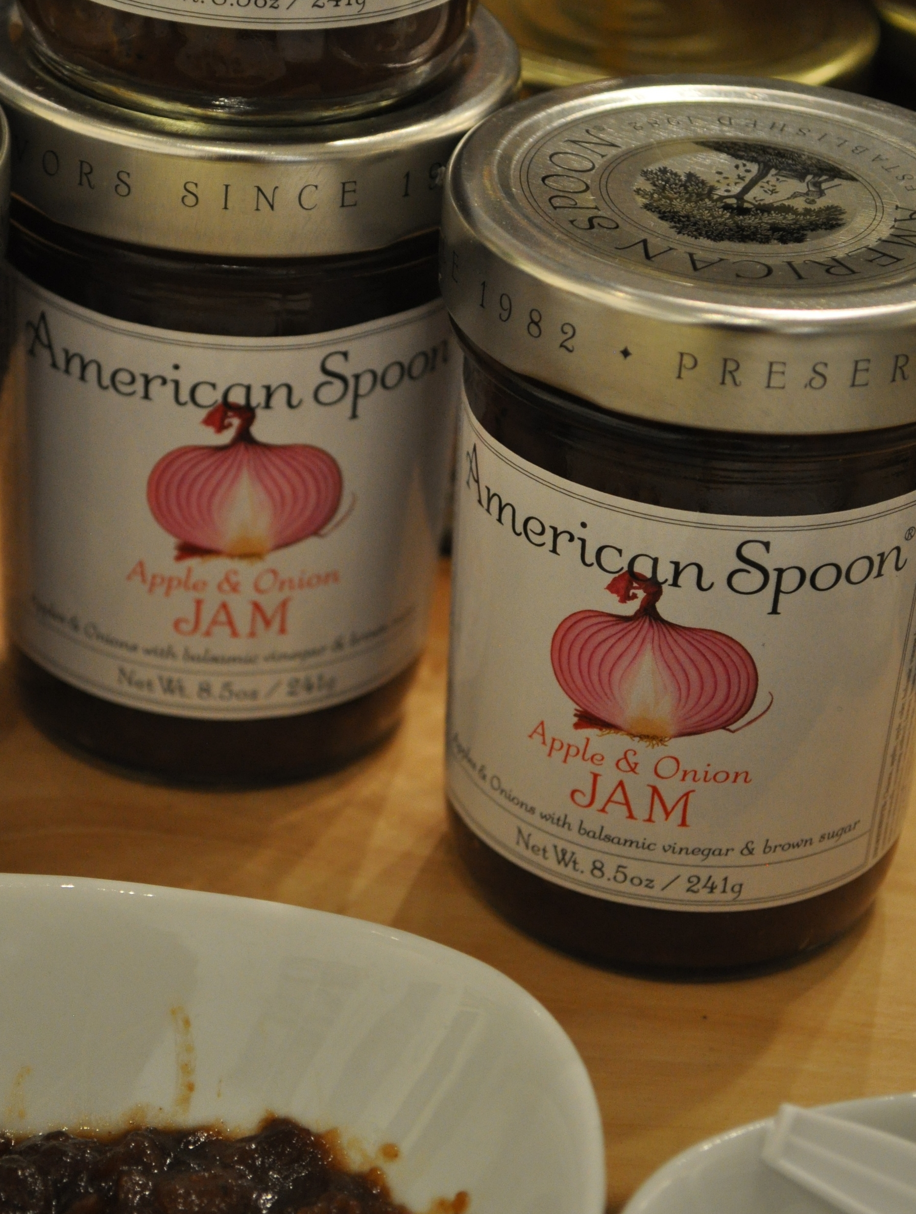 American Spoon's Apple and Onion Jam bursts with savory, sweet and tart flavors. Great to accompany a sharp cheddar cheese, or to turn your chicken or pork up a notch.