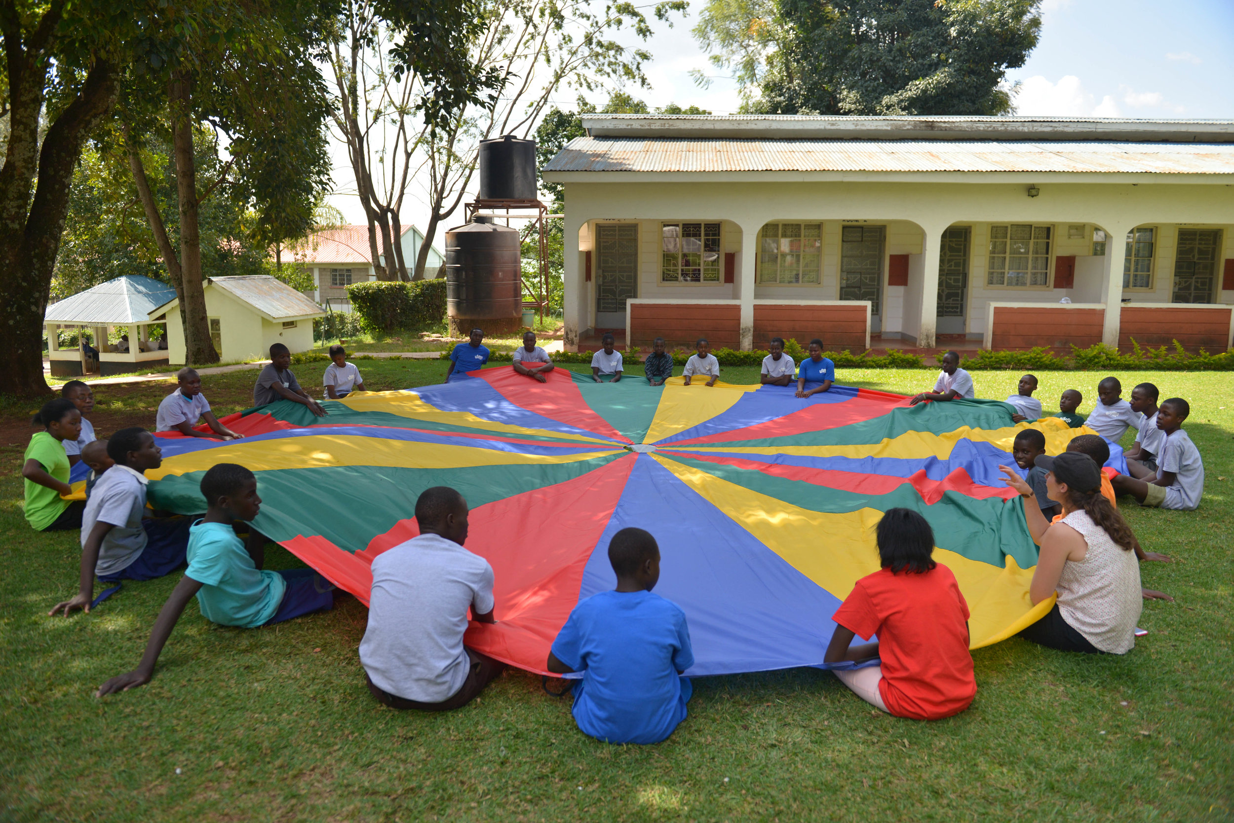 A photo of the students playing with a parachute at field day