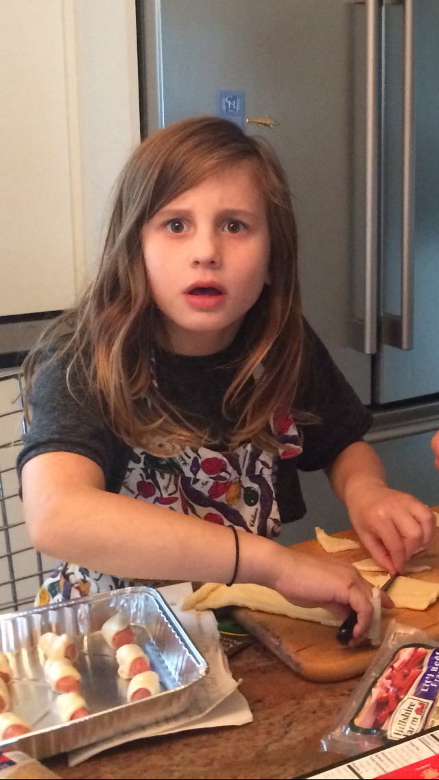 Goldberg's daughter, Chloe, makes pigs in blankets with Cranberry Pepper Jelly.