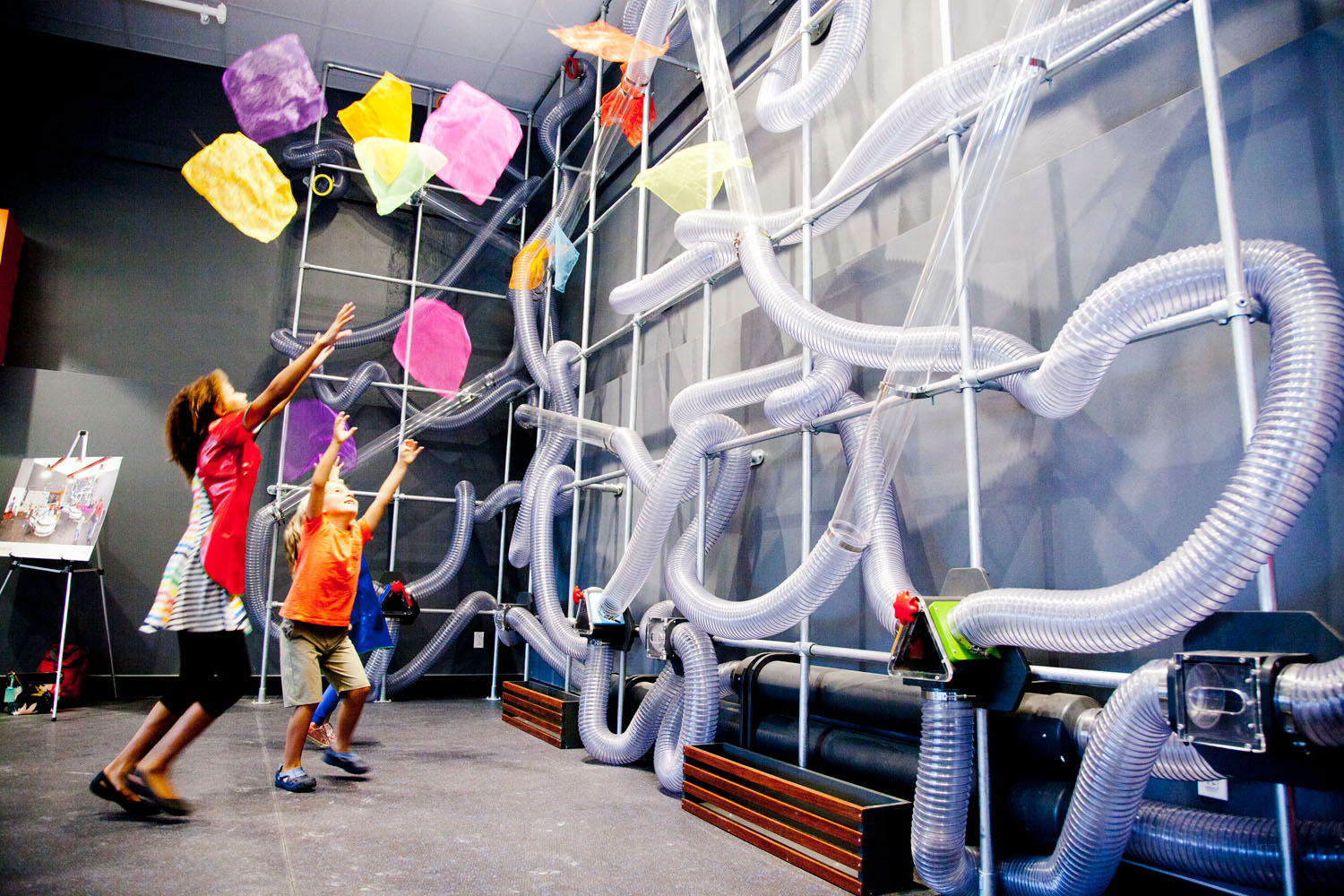 Children_Fascinated_by_Scarf_Air_Maze_at_the_Wonder_Lab_in_Childrens_Museum_of_Cleveland.jpg