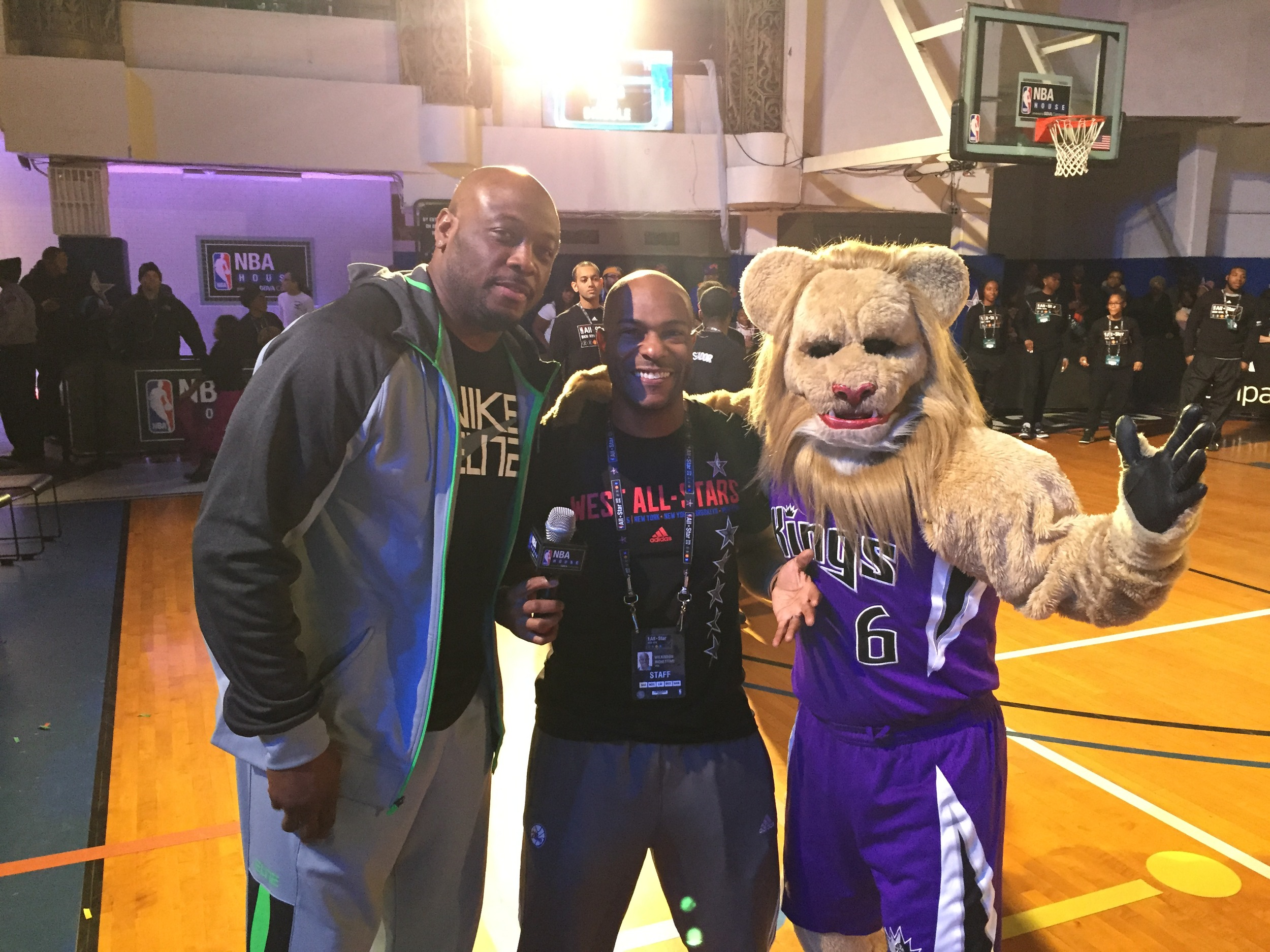 NBA Legend and mascot appearances were just a fraction of the action at NBA House. Here, event emcee, Wil, poses with Kings mascot Slamson and Legend Mitch Richmond.