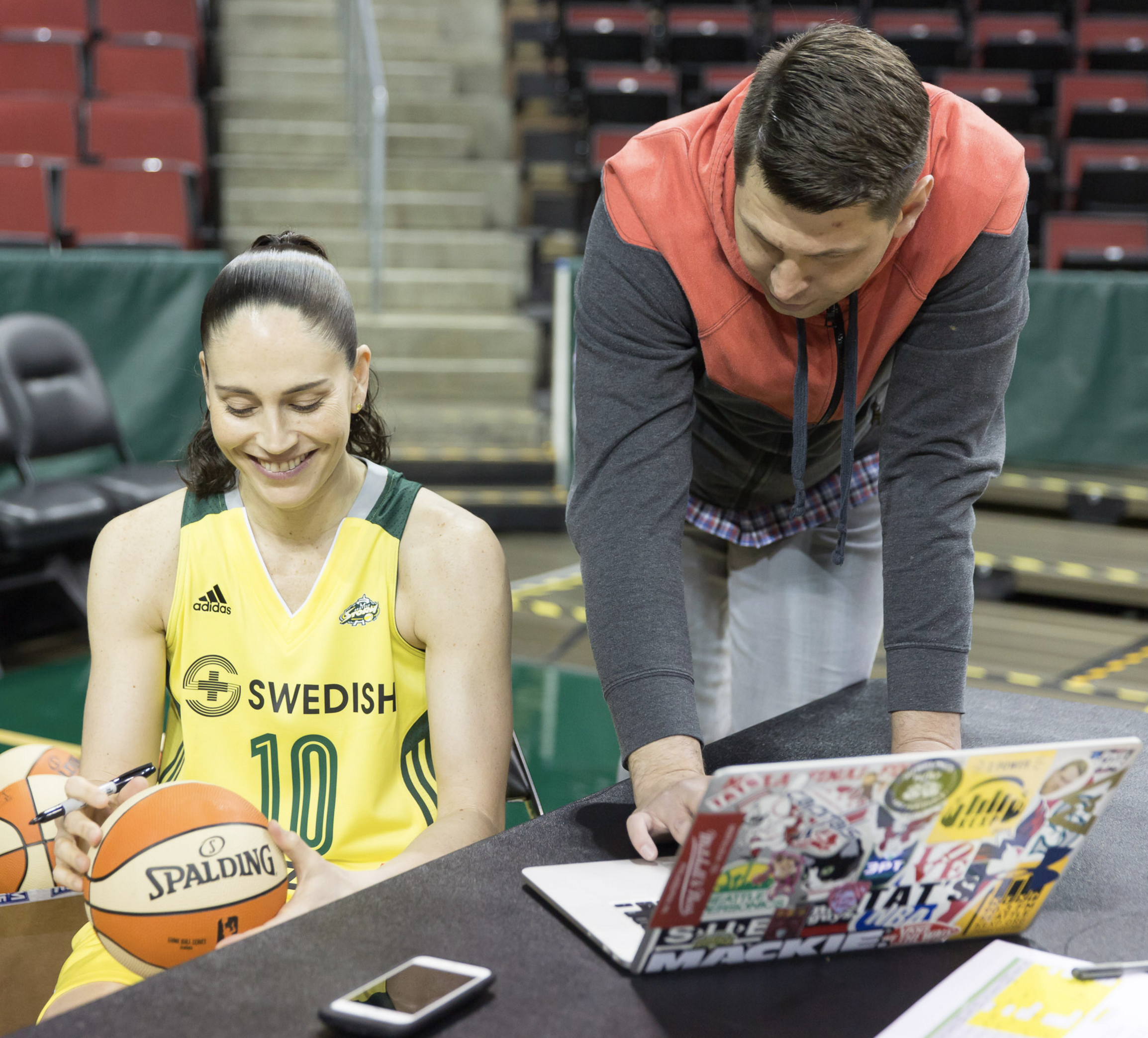 Sue Bird chuckles as we review some of her lines from a 'Fake News Report' script. (Neil Enns/Storm)