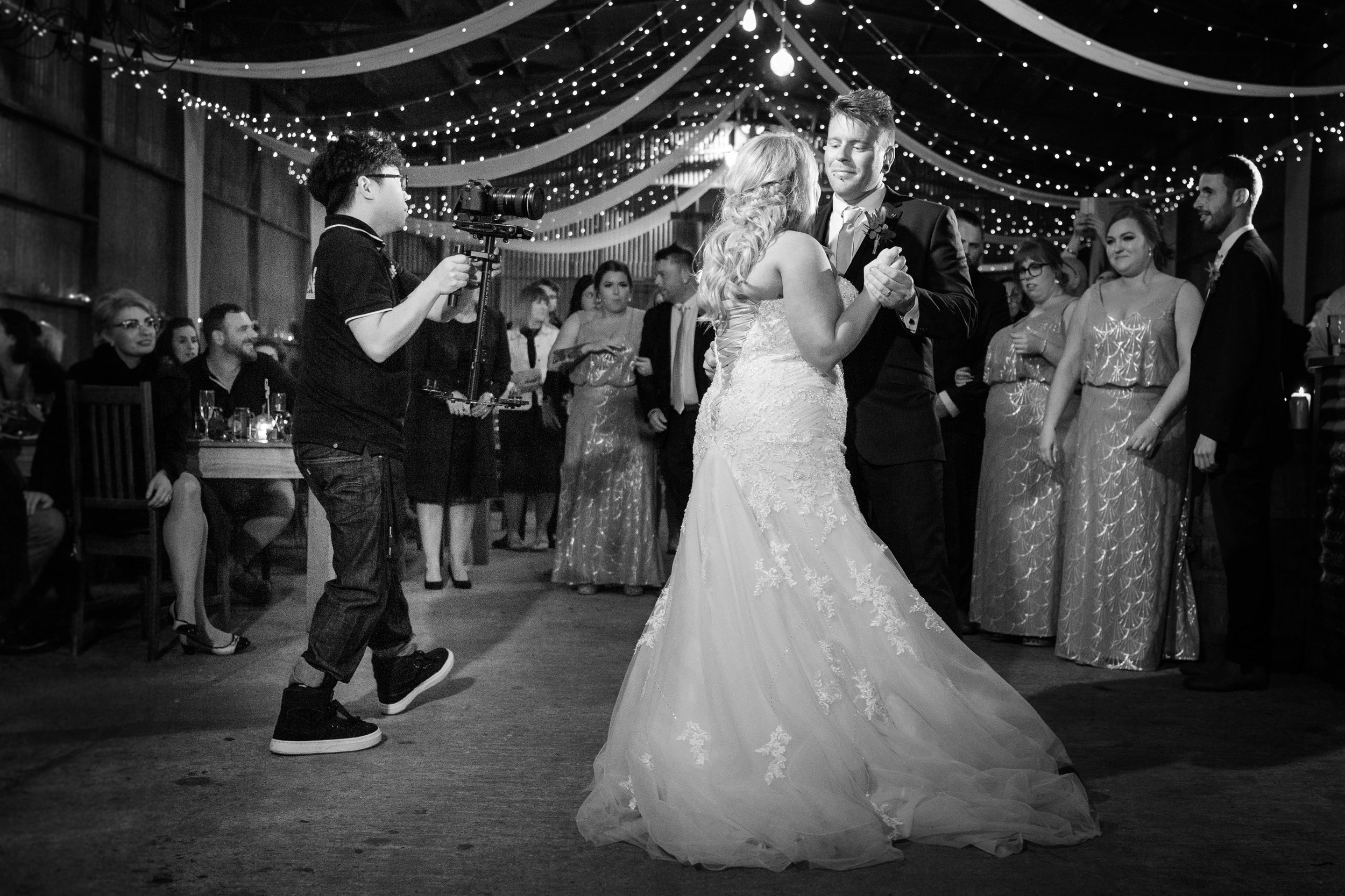 Behind the scenes shot of my good friend, professional videographer Henry Q from Hitman Productions capturing the first dance.