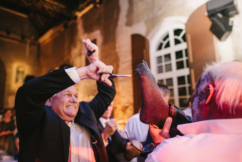 wedding cutting grooms socks ceremony