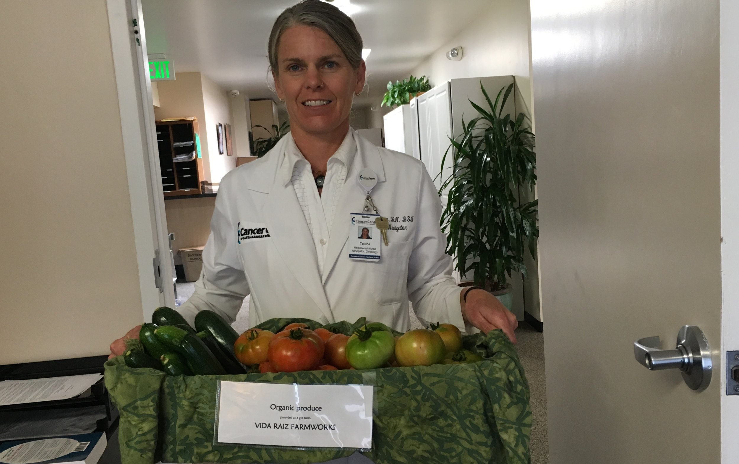Talitha with Cucumbers & Heirloom Tomatoes donated to the Cancer Center.