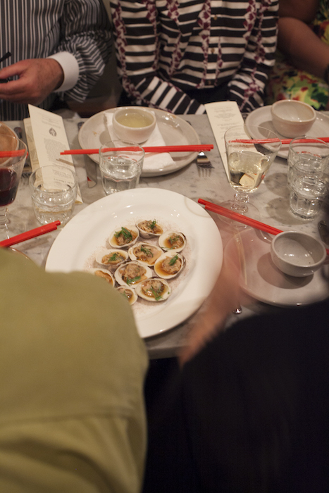 People eating oysters with red chopsticks.jpg