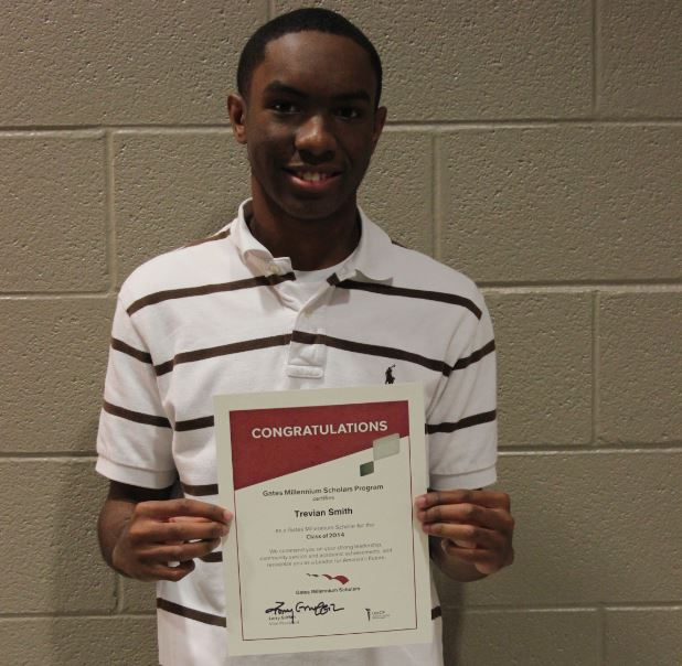Smith holding his Gates-Millennium Scholarship Award at Lee High School