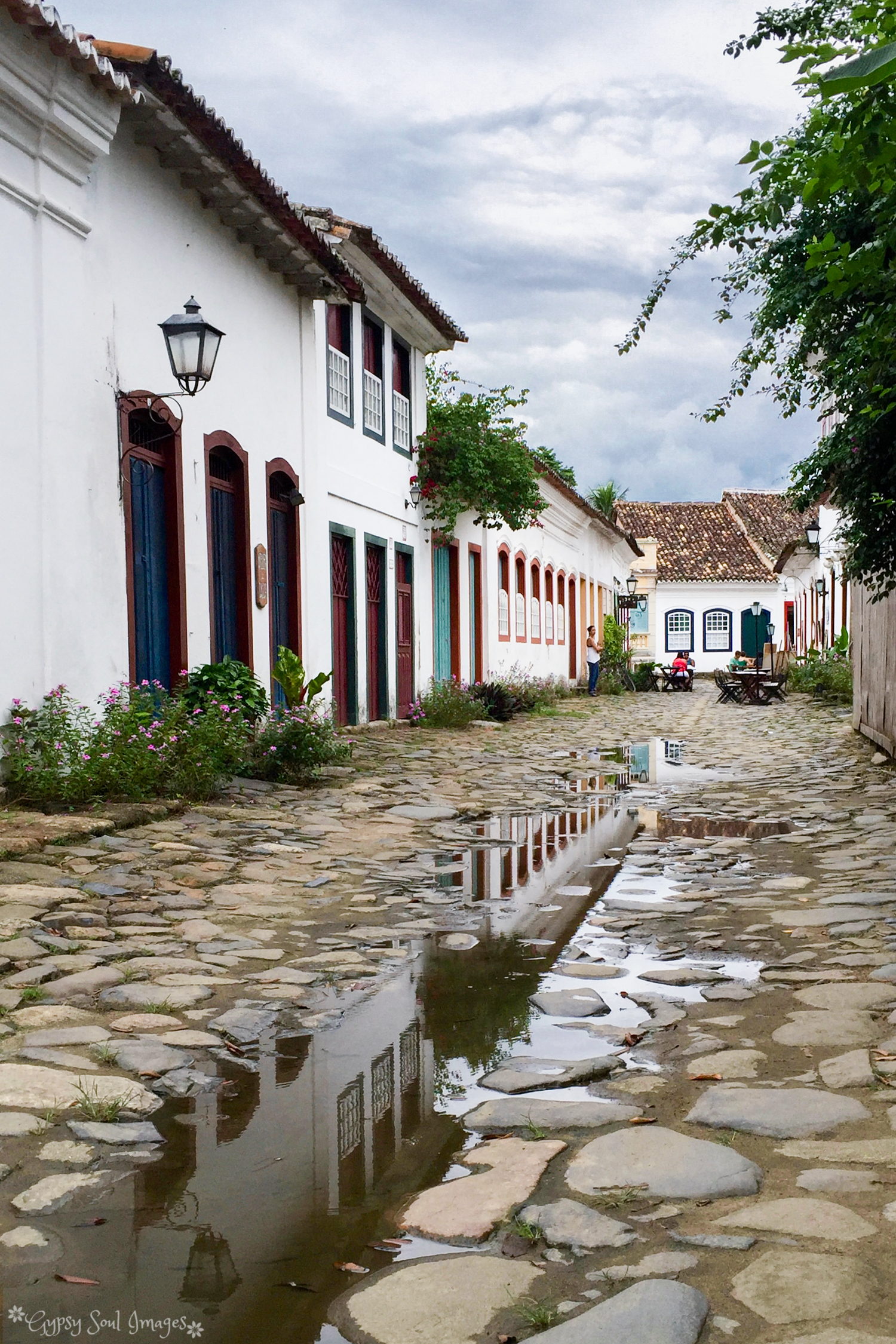 Picturesque Puddles - Paraty, Brazil Purchase this image in a variety of products from   Red Bubble  .