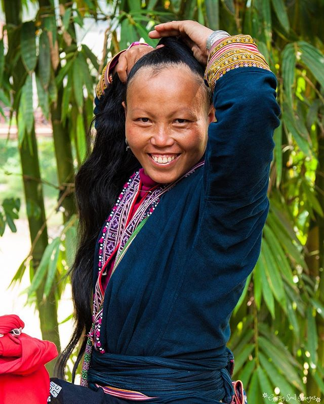 A Winning Smile - Sapa, Vietnam  Taumay is from the Red Dzao hill tribe and was our our trekking guide through the villages and rice paddies that surround Sapa.  Rarely seen without their traditional head dress in public, I felt privileged that she allowed me to snap this picture as she retied her hair. ❤️ #gypsysoulimages