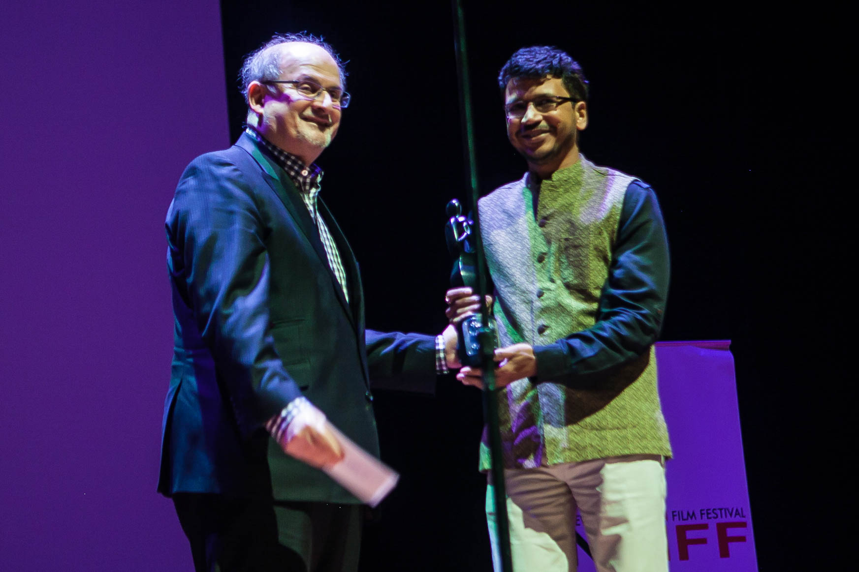 Photo Caption: Salman Rushdie presenting the award for Best Film accepted by Umesh Vinayak Kulkarni for HIGHWAY who also won Best Director for the film. (Photo credit: Mo Pitz)