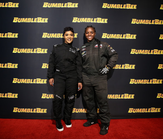 (L-R) Tia Norfleet and Brehanna Daniels attend the Glammed-Out Auto Clinic at West Coast Customs on behalf of BUMBLEBEE, in theatres December 21 (Photo Credit: Steven Baffo)