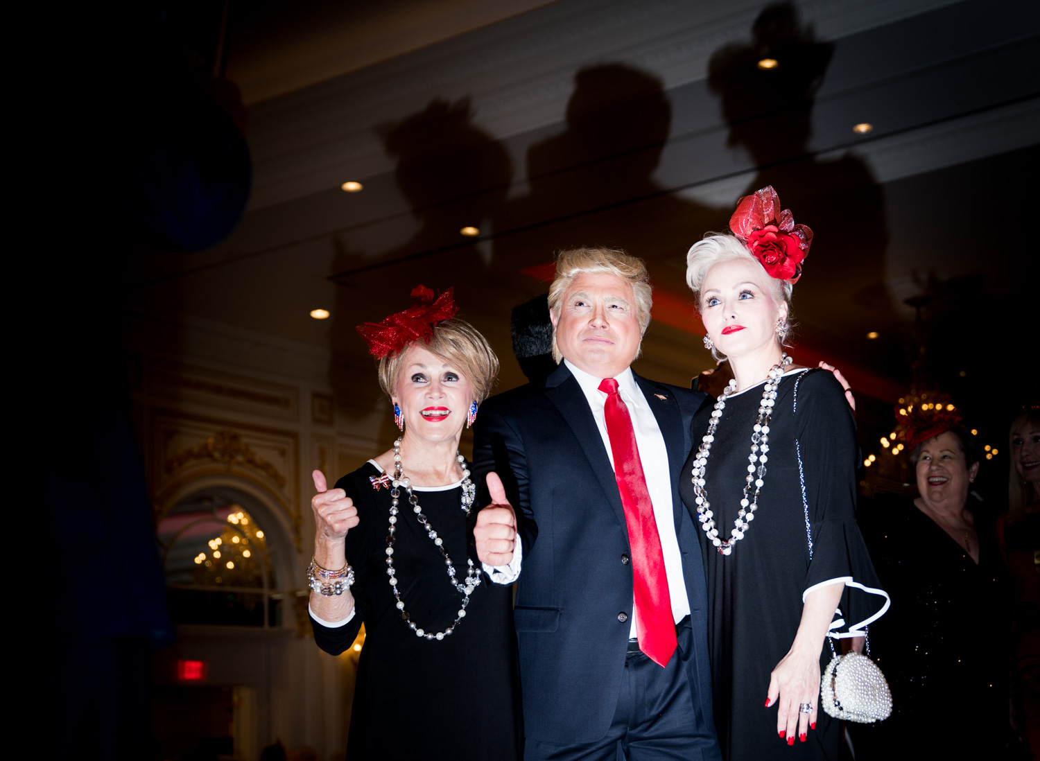 Guests at the Tea for Trump Birthday Extravaganza take a photo with a professional impersonator of President Trump at the Trump Hotel in Washington, DC on June 24, 2018.