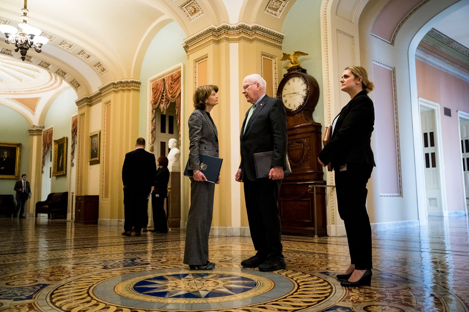 Senator Lisa Murkowski (R-AK) and Senator Patrick Leahy (D-VT) confer in the Ohio Clock corridor outside the Senate floor on Capitol Hill in Washington, DC on March 21, 2018. (Erin Schaff for The New York Times)