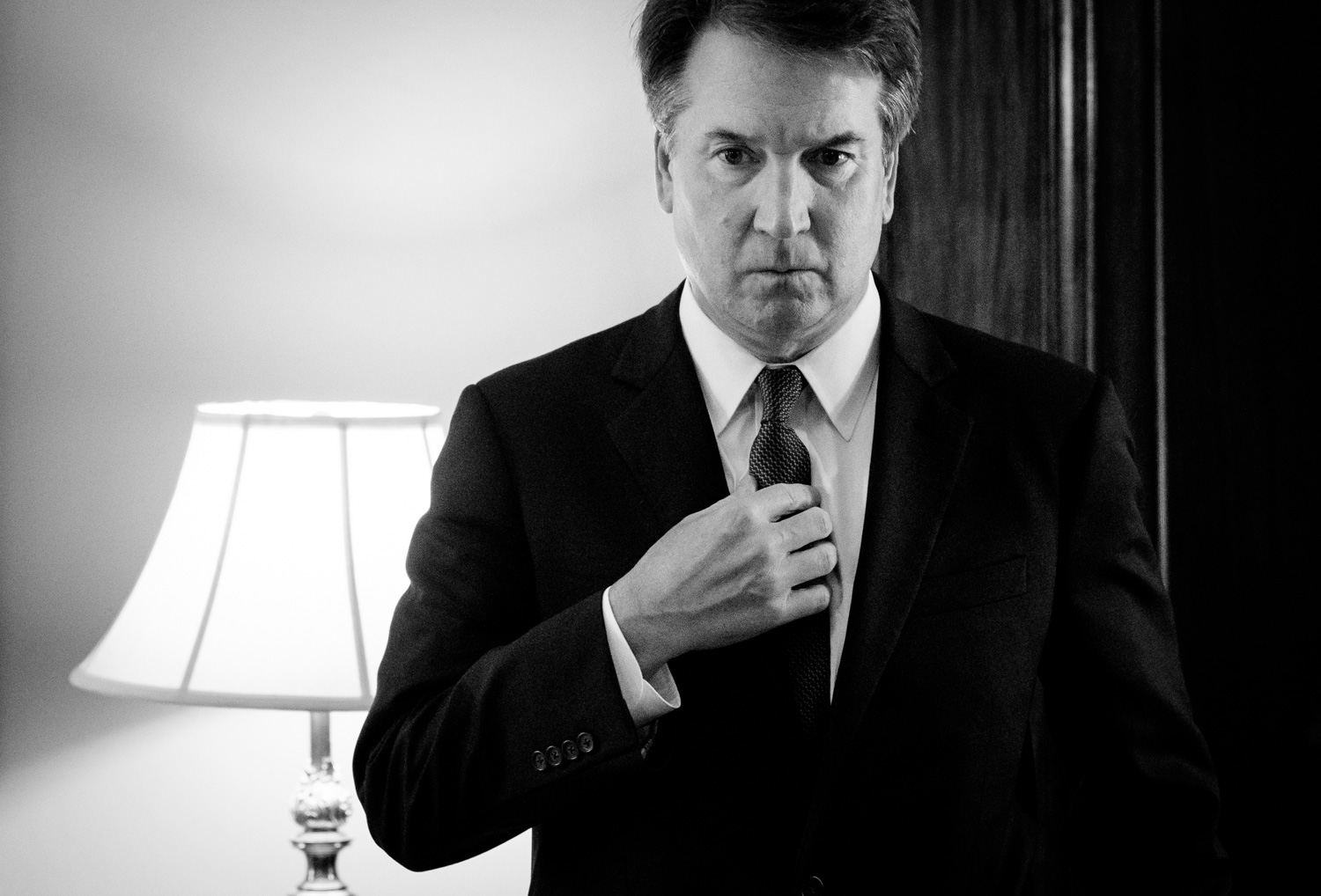 Judge Brett Kavanaugh, President Donald Trump's nominee for the Supreme Court, adjusts his tie in-between meetings with Senators on Capitol Hill in Washington, DC on July 30, 2018. (Photo by Erin Schaff for The New York Times)