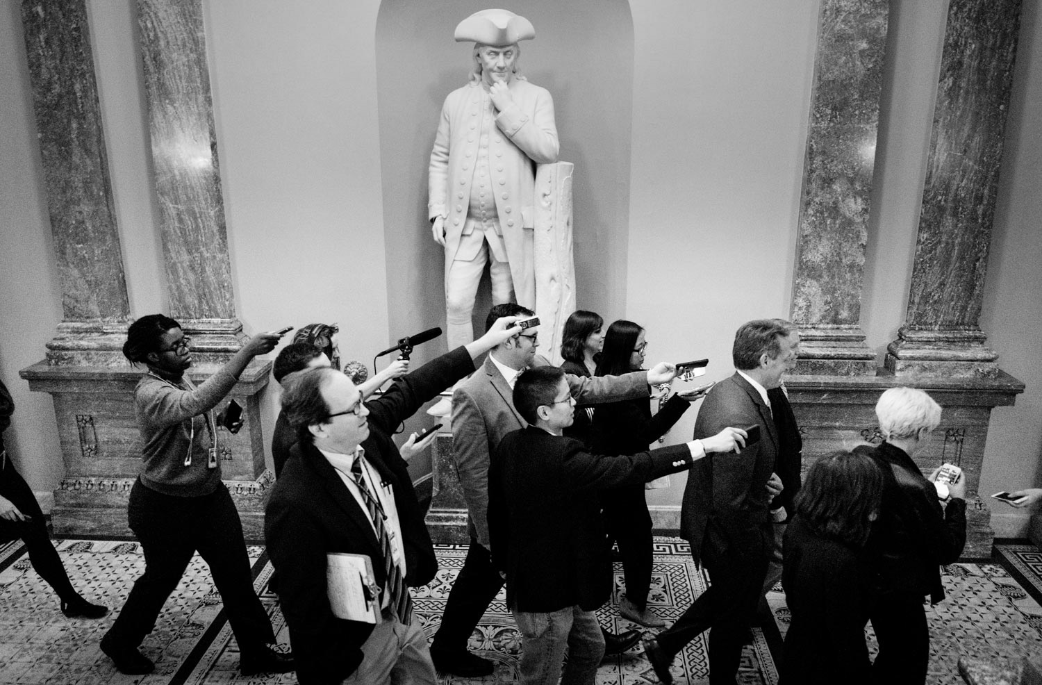 Reporters follow Sensators Jeff Flake (R-AZ.) and Lindsey Graham (R-SC) through the Capitol during a government shutdown in Washington, DC on January 20, 2018.