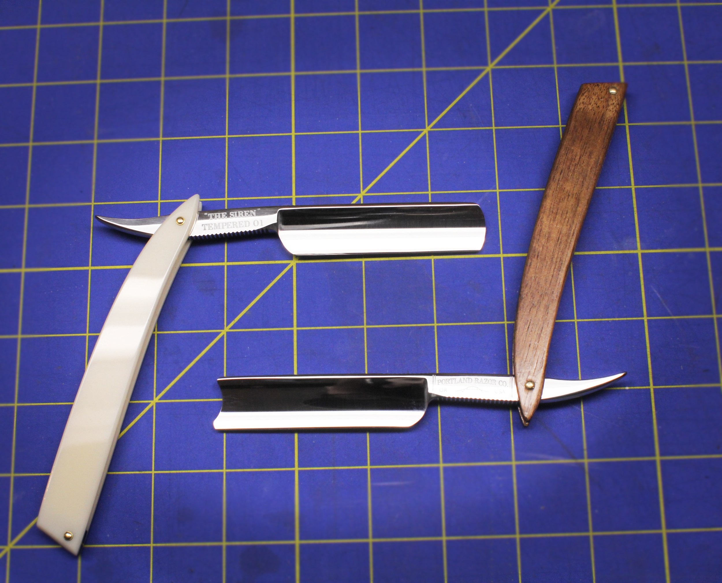 A look at two of our updated straight razors, side-by-side.