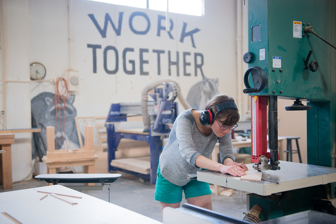 "The ""Work Together"" Mural in the ADX Woodshop."
