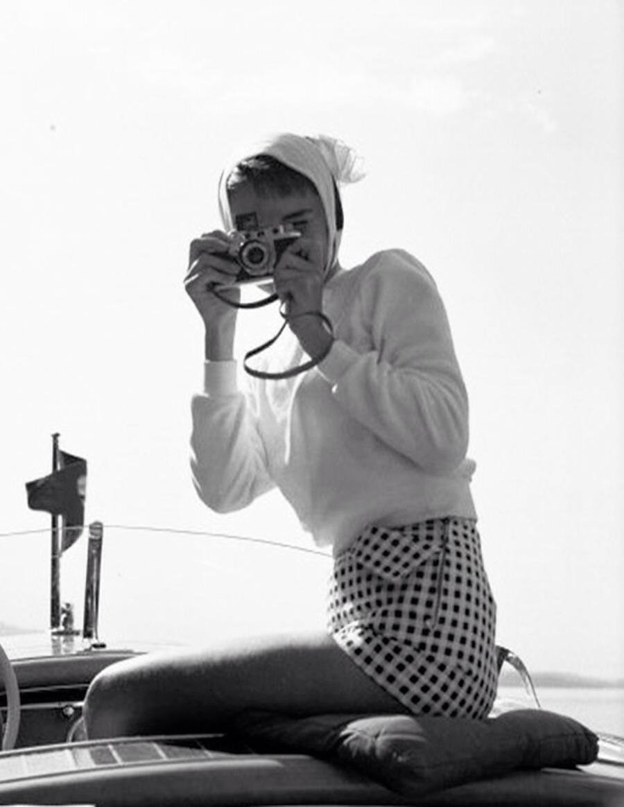 Model With Camera Wearing Check Shorts