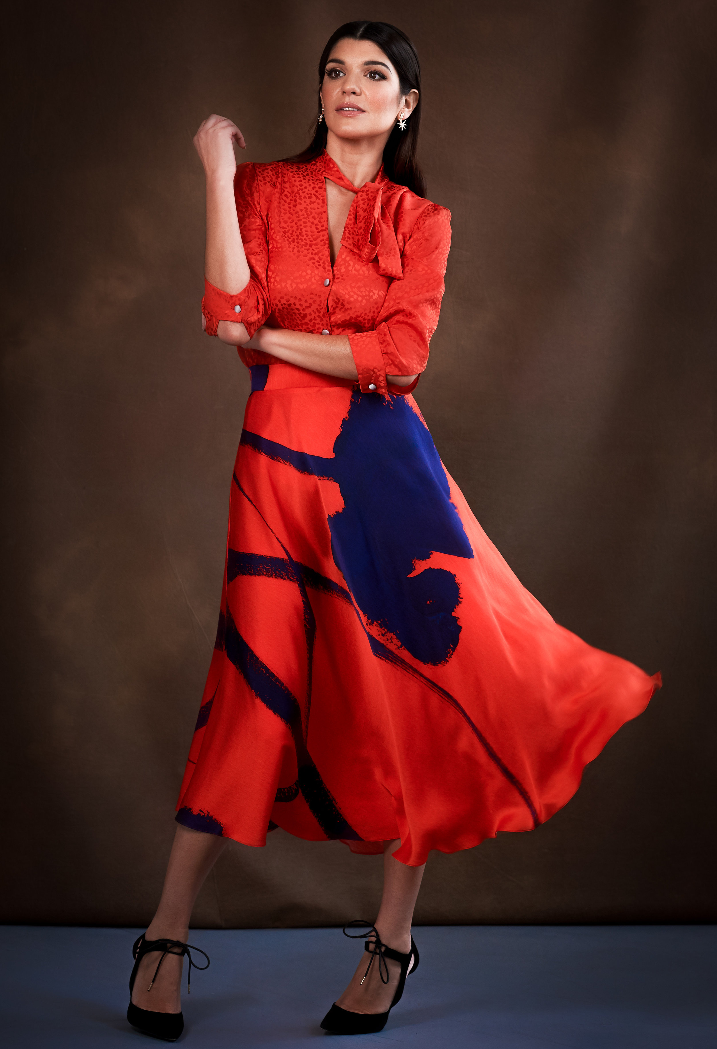 London Fashion Designer Ellie Lines' red silk Maddie blouse and Dora skirt