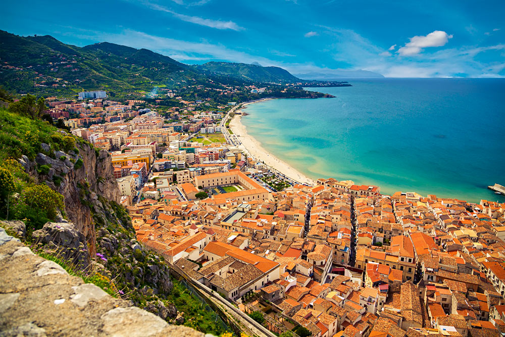 Upper-view-of-bright-orange-roofs-near-the-sea-in-Cefalu-Sicily-Italy_287341241.jpg