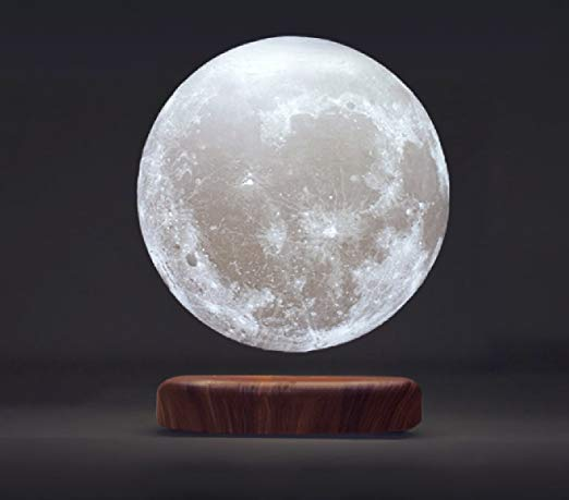 Levitating Moon Lamp   My sister-in-law got this for me for Christmas and it is the coolest gift ever. The base needs to be plugged in, and once it is the moon will levitate, spin and LIGHT UP giving you an amazing little moon lamp.