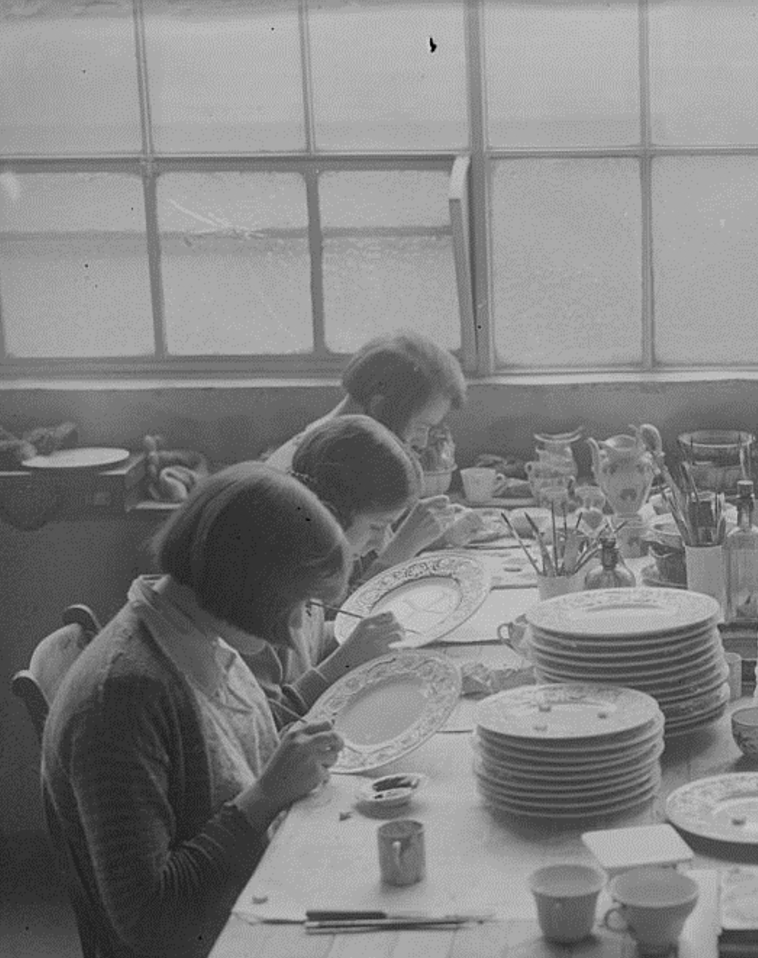 Women painting decoration on plates at the Wedgwood Pottery, c 1930.