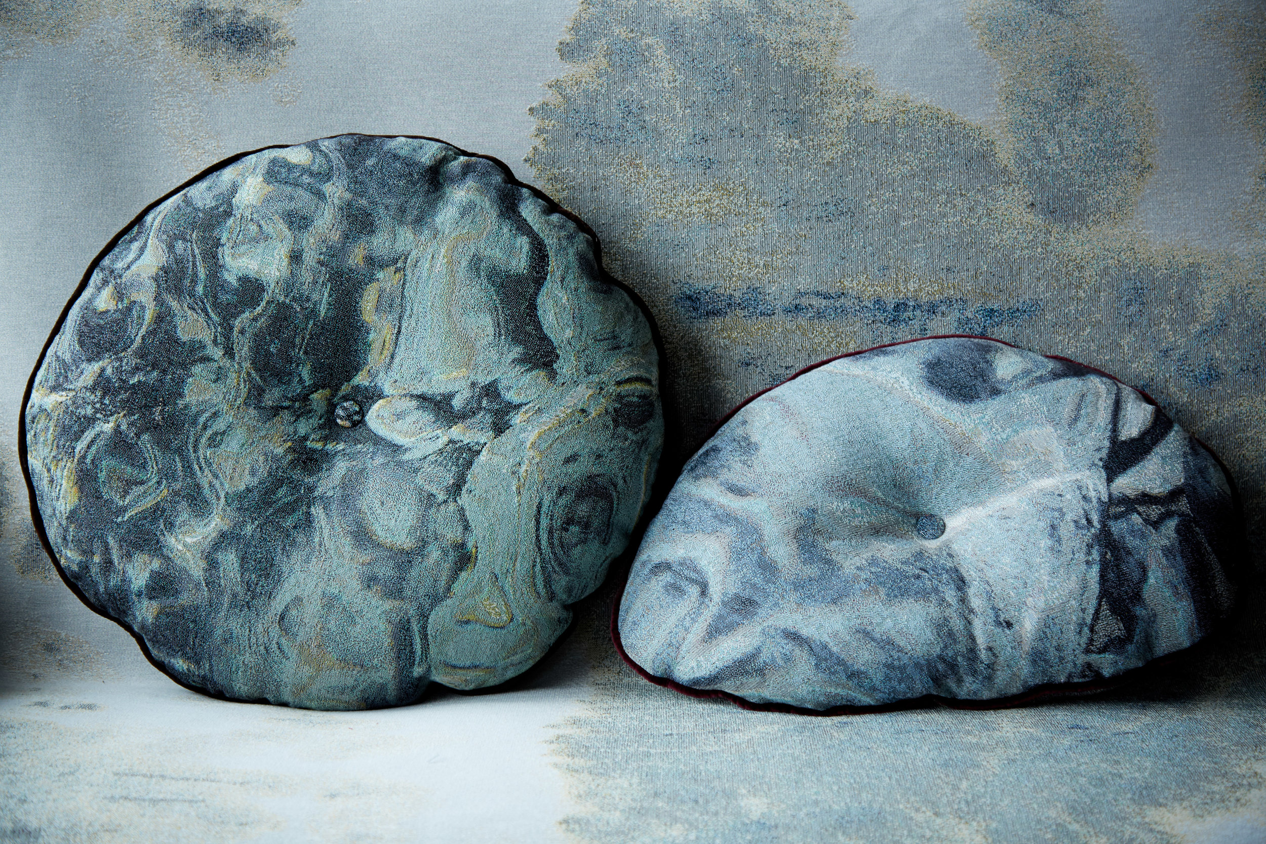 "MTS ""Almost Circular"" tapestry pillow, in Radiant & ""Pebble"" pillow, in Swirl."