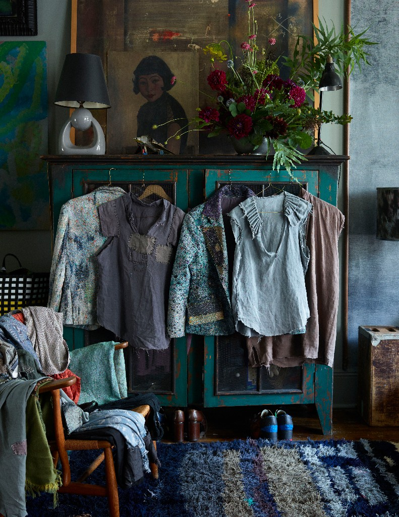 Martyn's collection of self-made, vintage and custom-made clothing hanging below a flower arrangement by Livia Cetti.