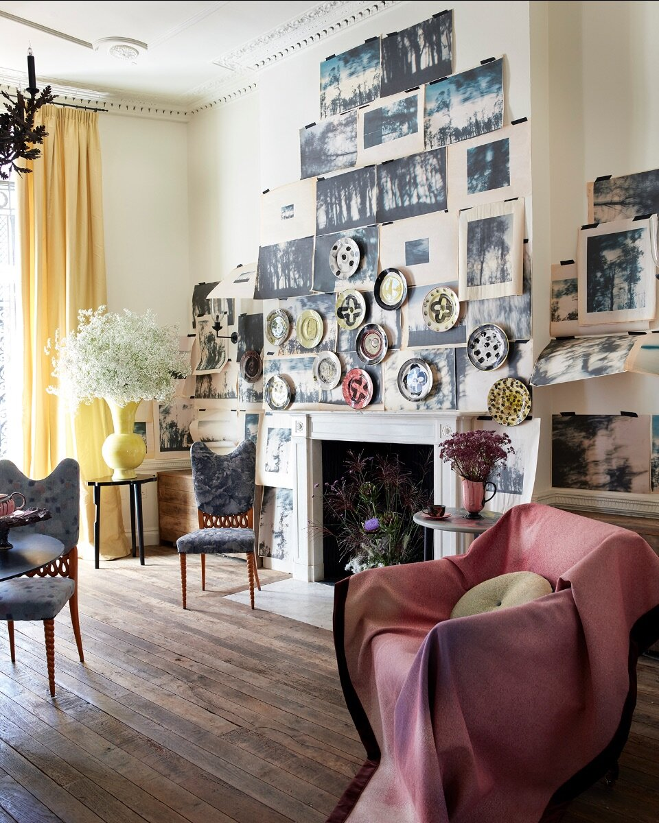 This wall is layered in photographic prints on butchers paper from my Tree series. Sitting on top are hand painted plates from 1882Ltd. Vintage dining chairs and pink throw upholstered in new MTS jacquards.
