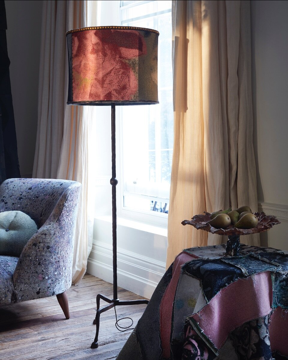 A lampshade in Pink Peony tapestry with a Dove Drury Hornbuckle pedestal ceramic on an MTS jacquard patchwork.