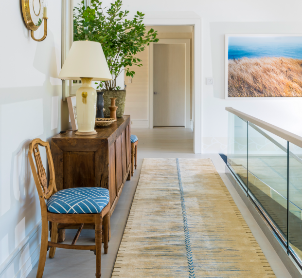 McGrath II designed this sweeping hallway space in last year's house, incorporating rustic and refined elements