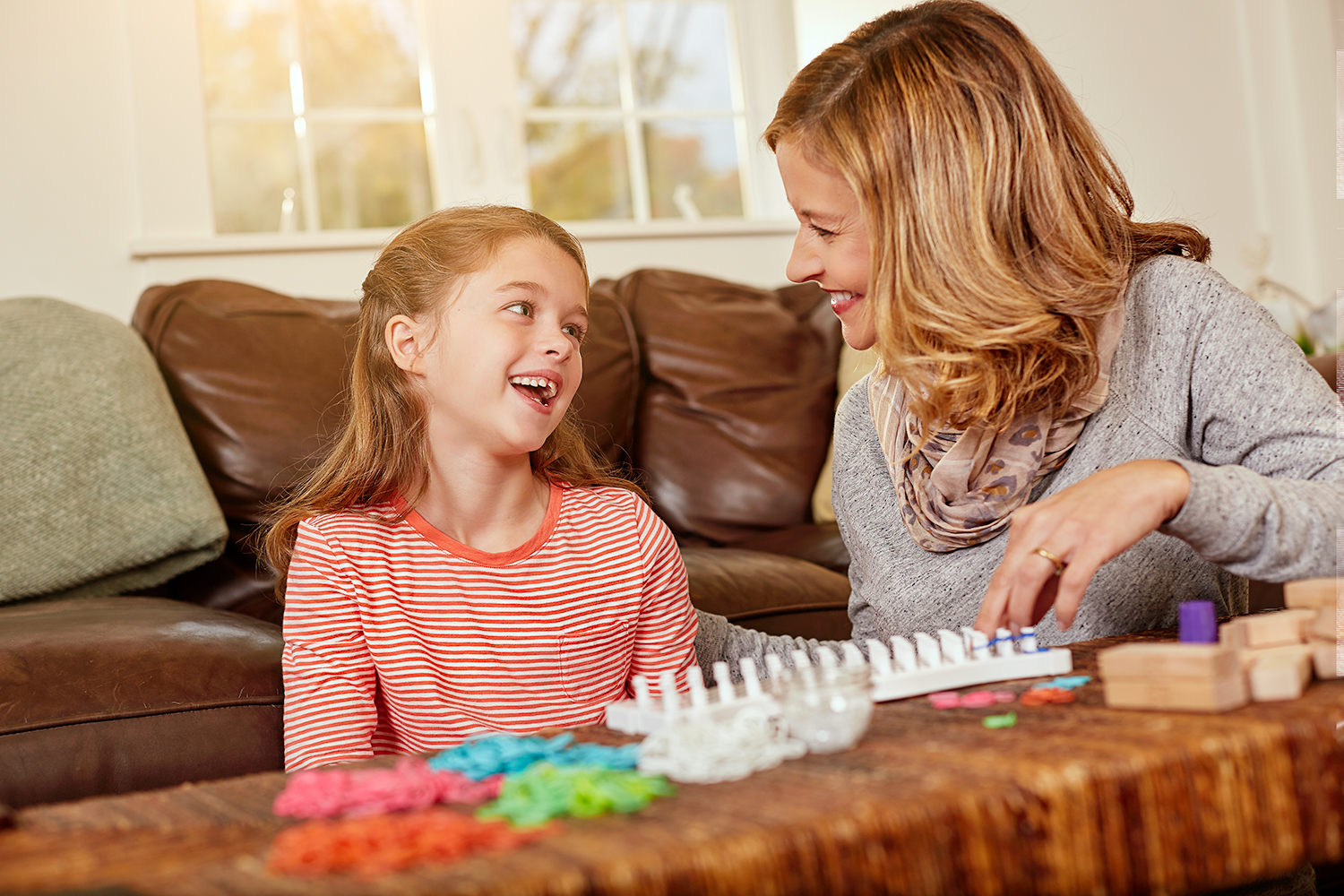 mother and daughter playing in living room.jpg