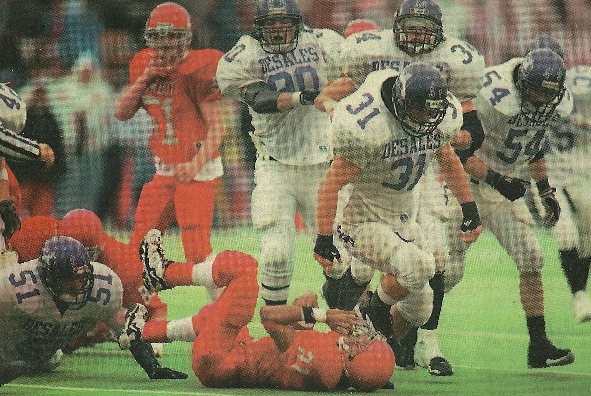 Tom Weilbacher (31) and Grant Bowman (51) combine for the stop in the 1997 State Championship game (photo credit - Columbus Dispatch)
