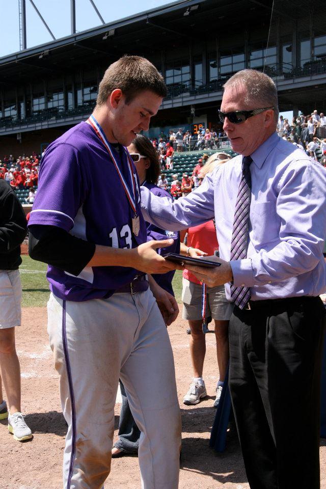 Senior Nick Eltzroth receives some hardware from Principal Dan Garrick