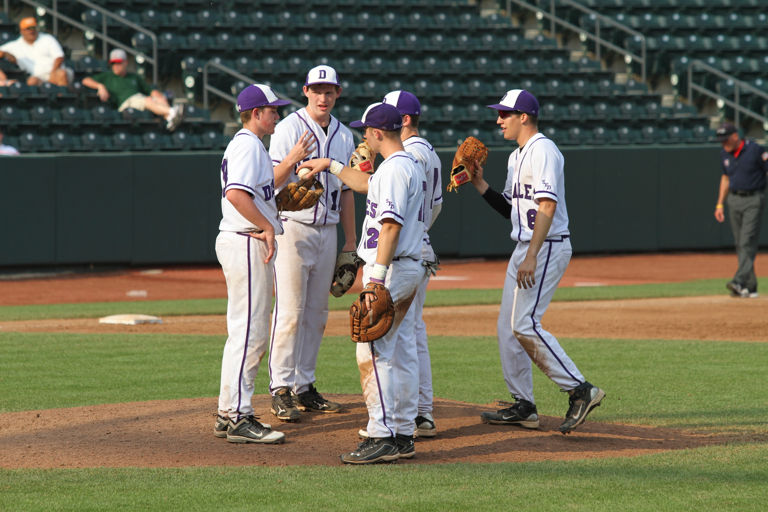 Player meeting at the mound in the title game
