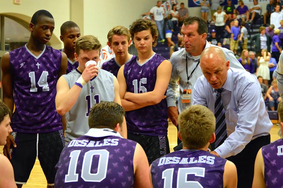 Coach Feltz talks to his team during a timeout