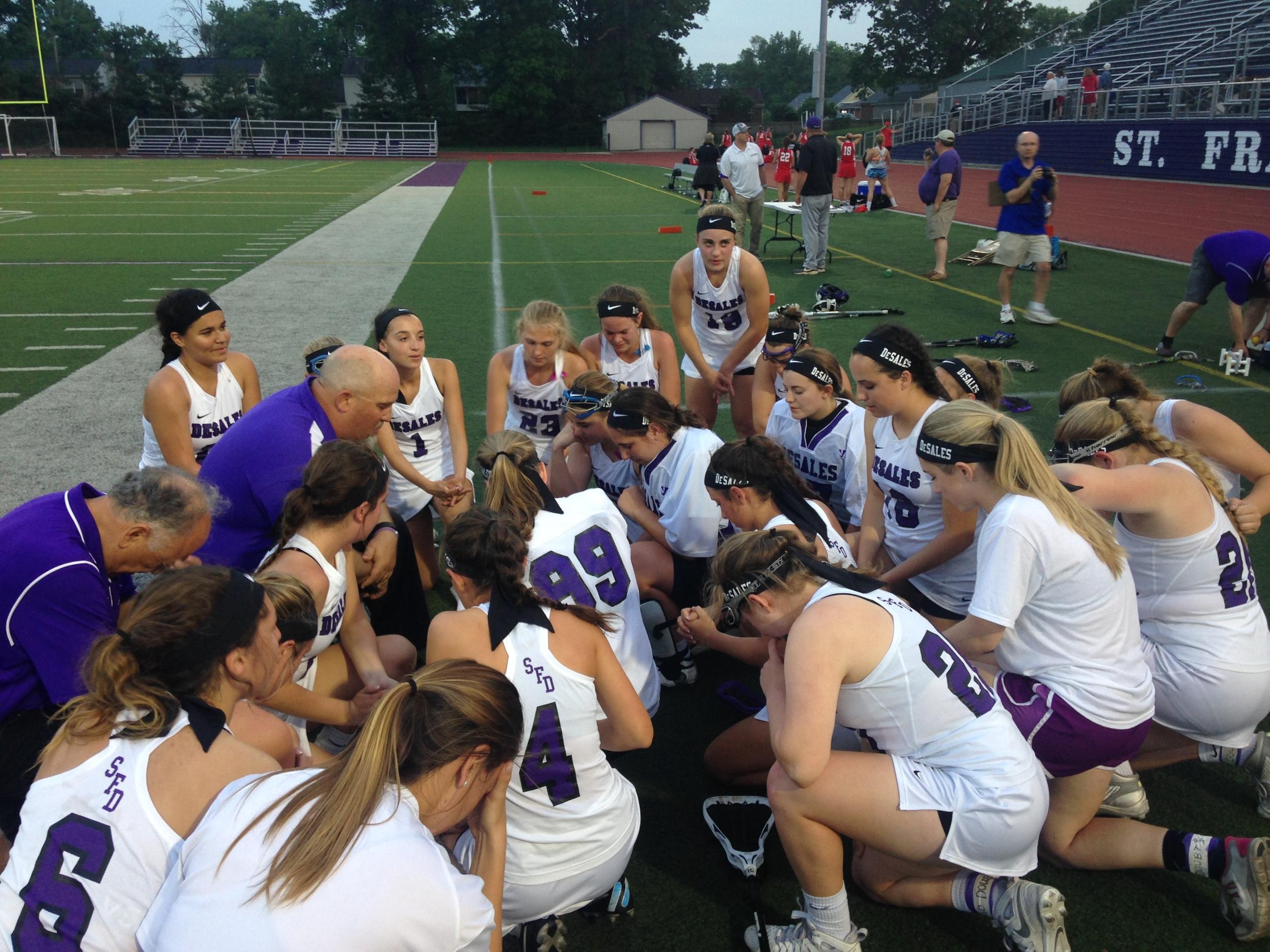 Postgame prayer after capturing the program's first Regional title