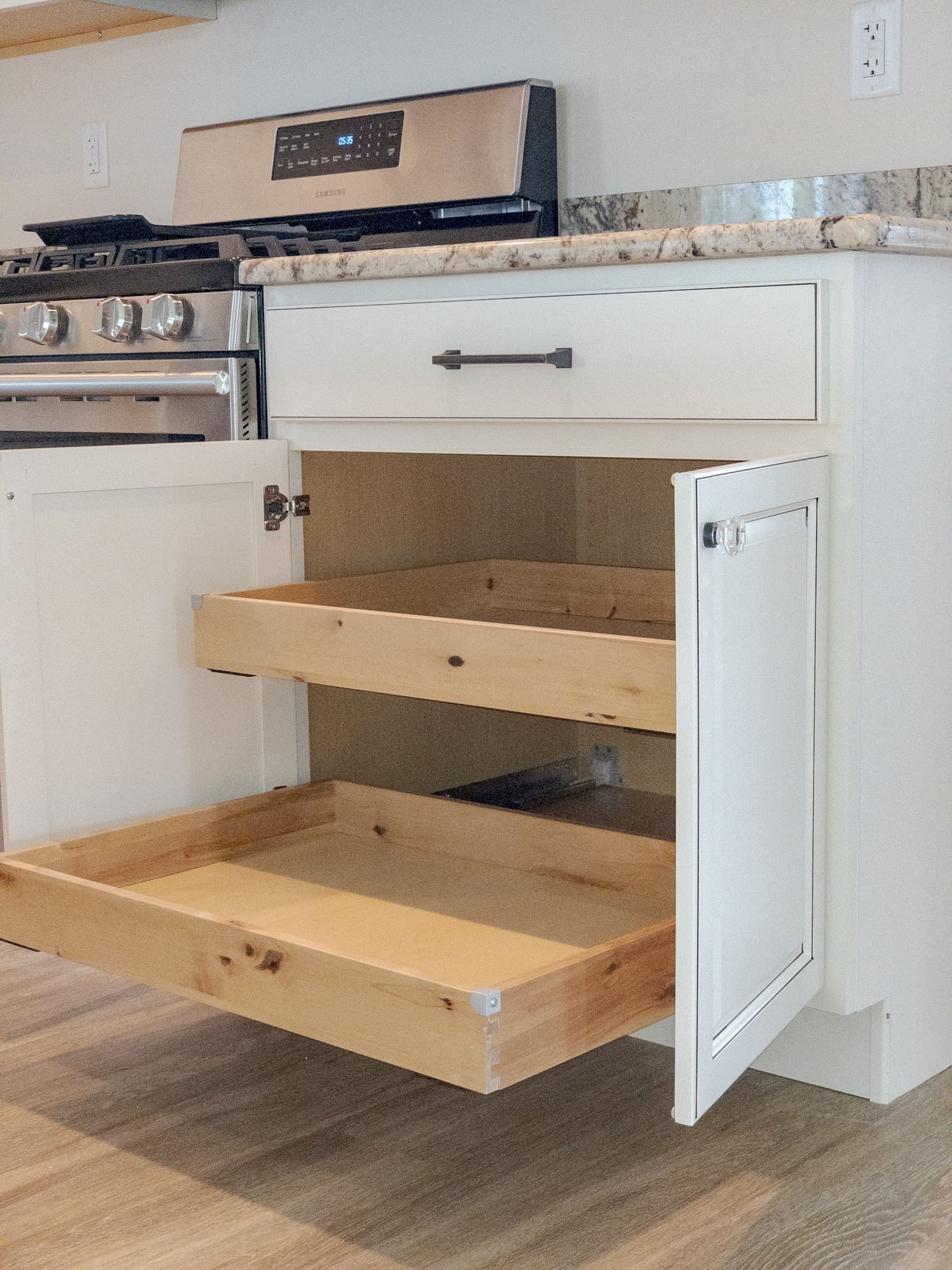 Kitchen pull outs in cabinet by gas range.jpg