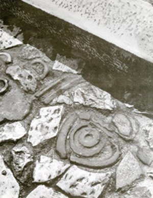 Figure 10. Path detail showing fragments of ornamental ceramics embedded within paving