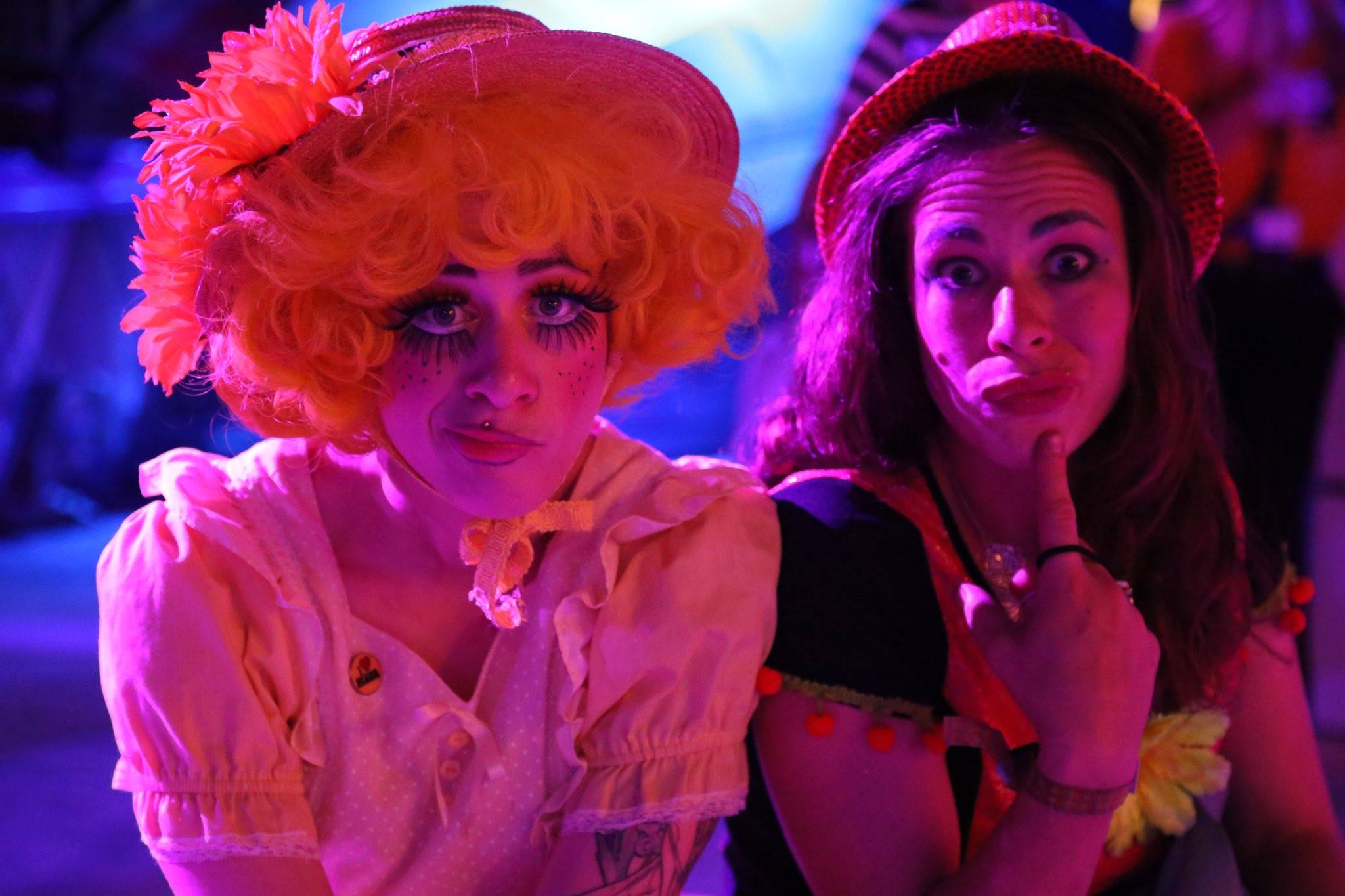 Midway ensemble players Lil Gitsy and Trixie taking a break in the high 90's nightime heat