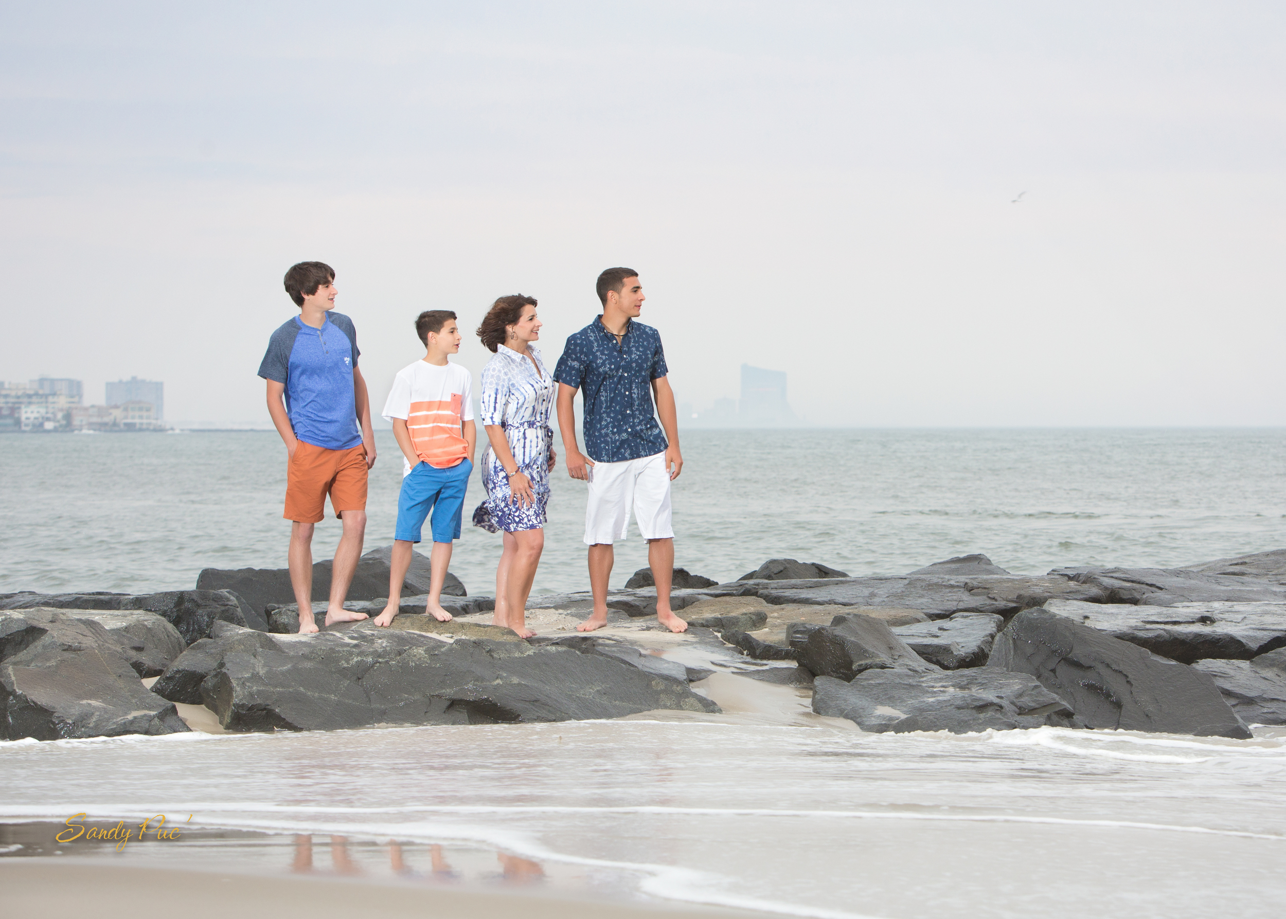 Ocean City, NJ has one of the best beaches to have family pictures taken on.  Here is my own family and this is a great family picture pose, thanks to Sandy Puc'.
