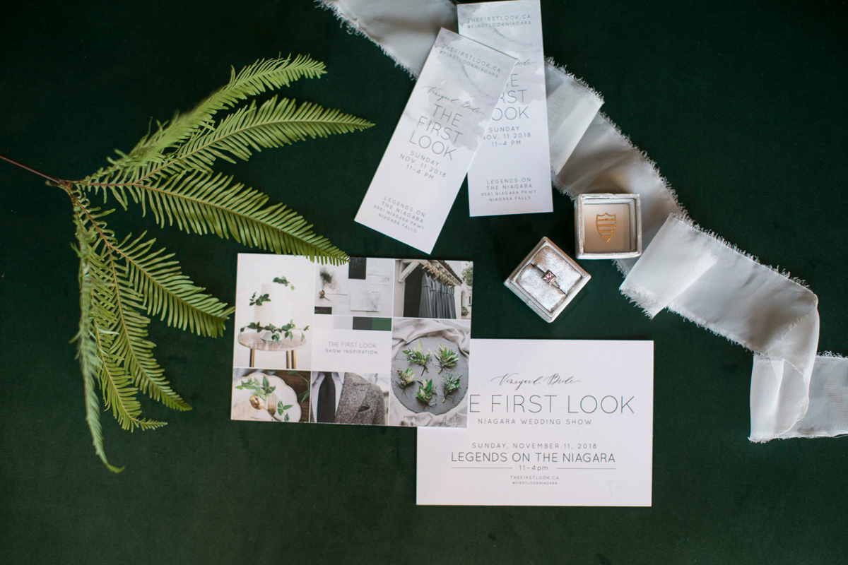 flatlay of first look autumn wedding show tickets and promotional materials