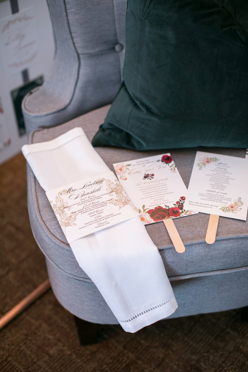 fltlay of wedding day stationary with linens and armchair