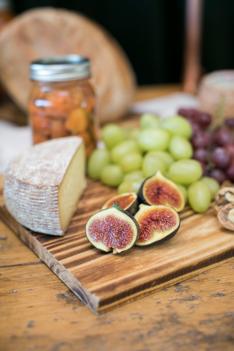 charcuterie board with brie, figs and grapes