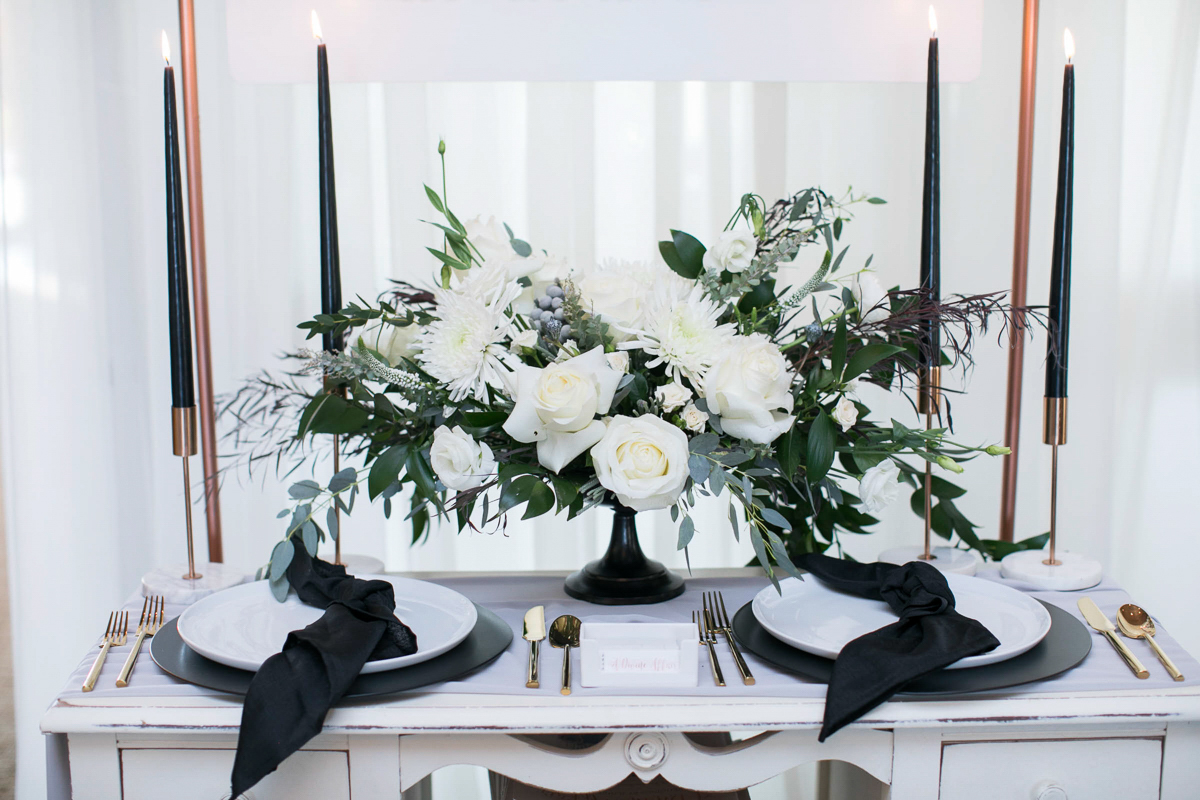 tall candles and floral wedding day tablescape