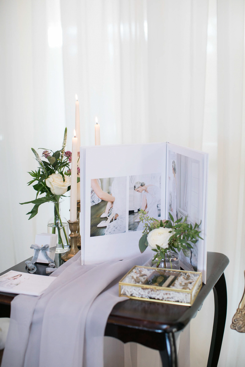 wedding day tablescape with candles, linens and florals