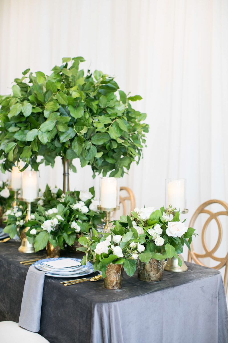 wedding day tablescape with velvet linens and tall greenery