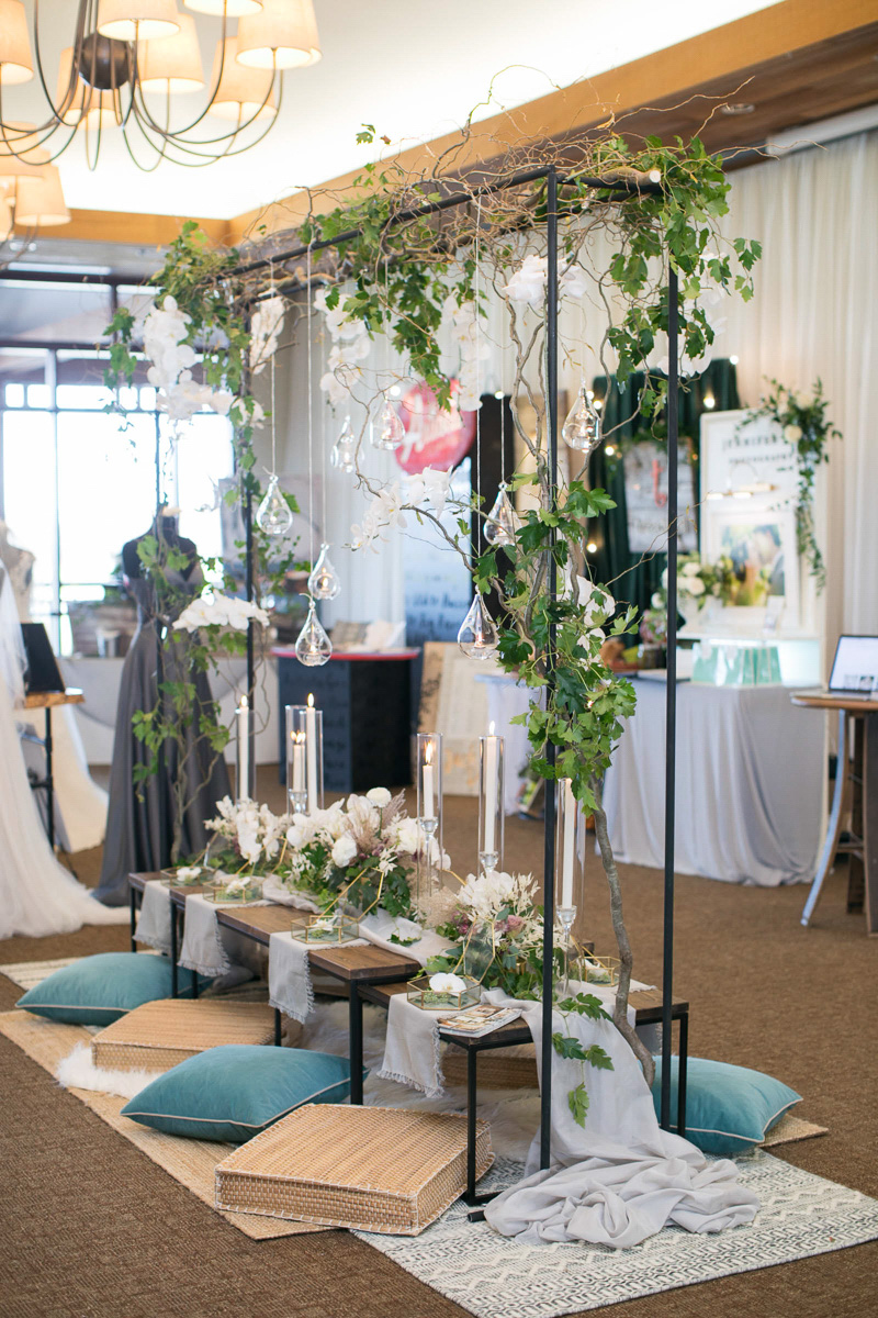 wedding day tablescape with metal and greenery structure